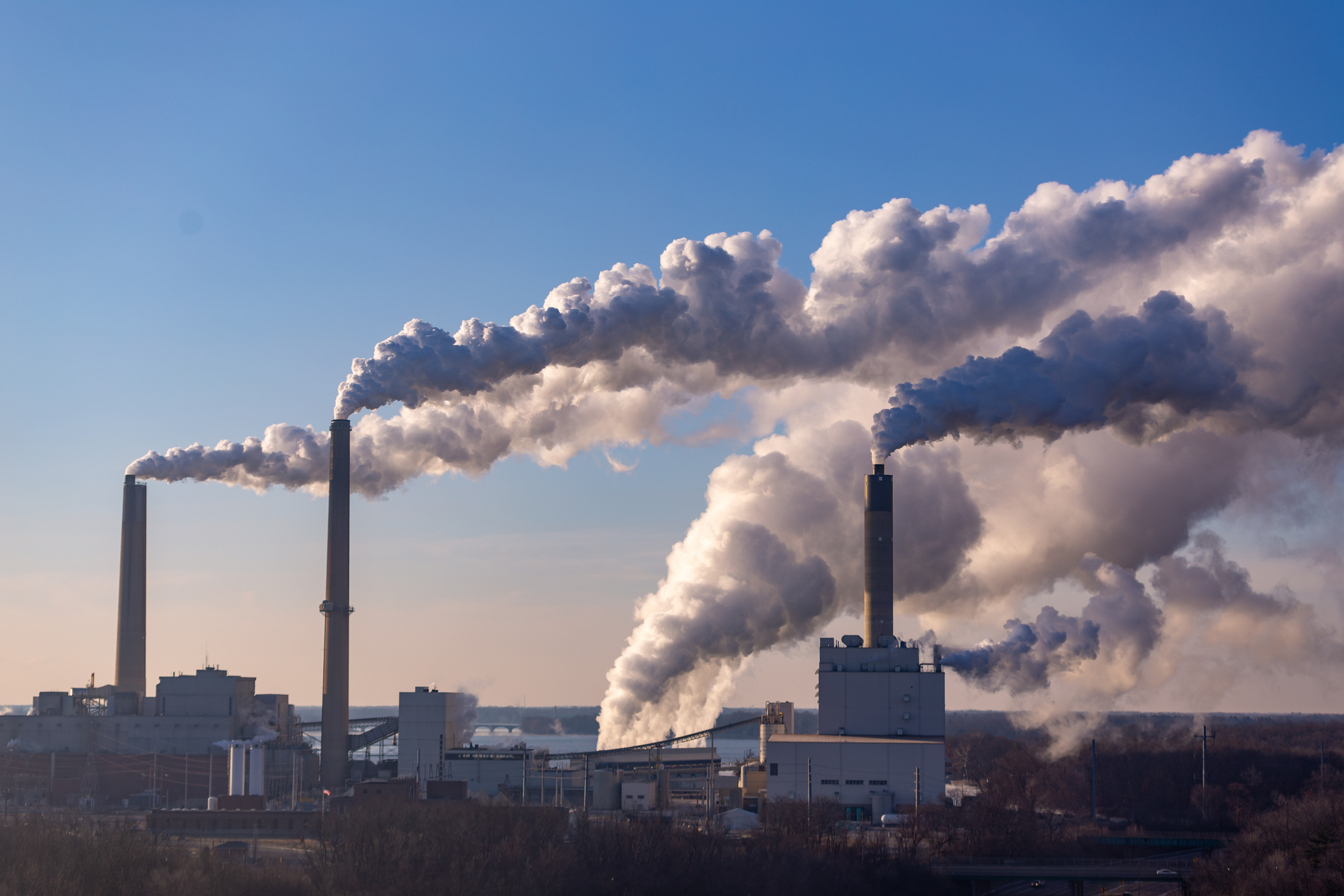 Greenhouse gases emanating from factory chimneys