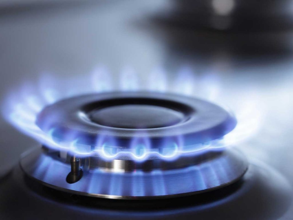 Natural gas flame on cooktop